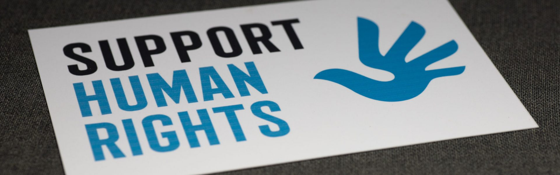 Support Human Rights protest sign on Feb. 5, 2021. (Sean Flynn/UConn Photo)